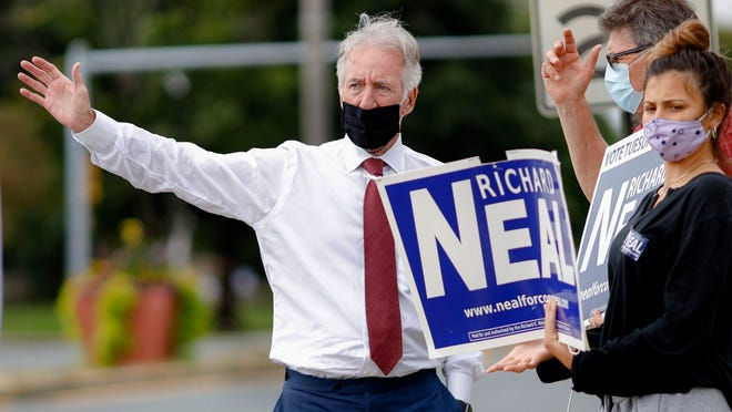 U.S. Rep. Richard Neal , D-Mass., stands with supporters gathered at the corner of East Street and Fourth Street in Pittsfield on primary election day, Tuesday.