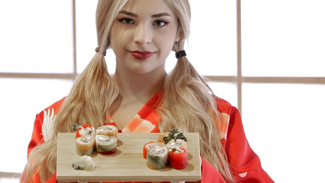 Lizzette Preciado shows off the Cherry Blossom Sushi at Kangnam Style Sushi, Karaoke and Spirits at 1550 Hawkins.