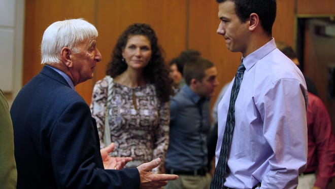 Section V football chairman Dick Cerone, left, attempts to talk with Aquinas quarterback Jake Zembiec, right, after state Supreme Court Justice J. Scott Odorisi heard arguments Friday morning in Aquinas' lawsuit. At center is Zembiec's mother, Maureen Zembiec.