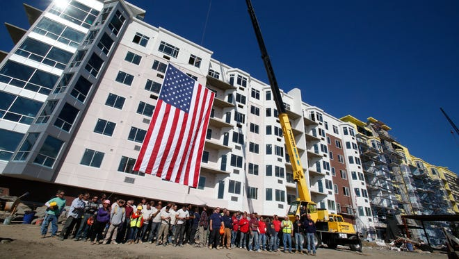 More than 200 construction workers were at Thursday's ceremony marking the completion of the installation of the roof at Harbor Square in Ossining.