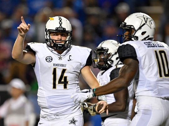 Vanderbilt quarterback Kyle Shurmur (14) gestures after
