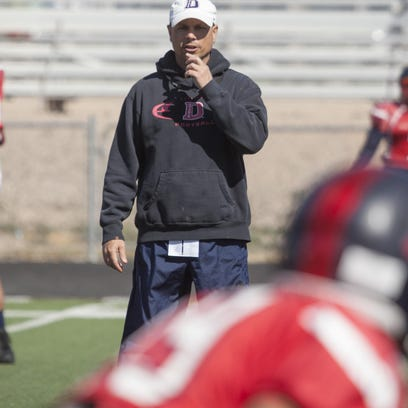Dixie State Head Coach Shay McClure coaches his team during practice Wednesday, March 30, 2016.