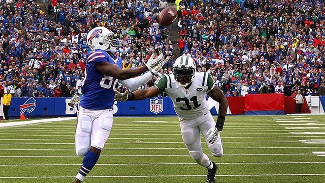 Bills receiver Marquise Goodwin (88) hauls in this 43-yard TD pass against the Jets Antonio Cromartie (31). The Bills beat the Jets 37-14 on Sunday.