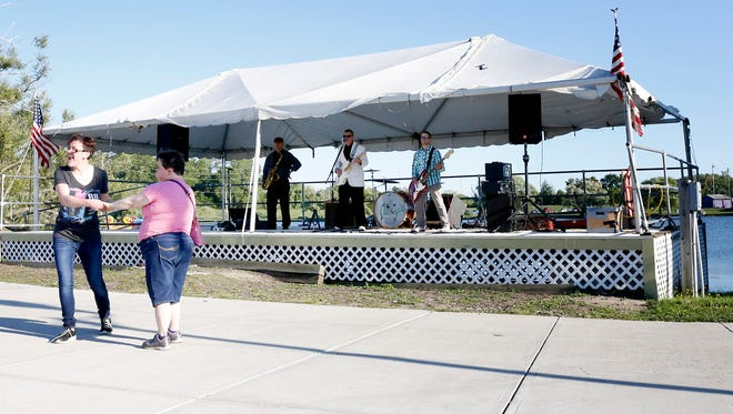 The sounds of Steve Southworth and the Rockabilly Rays draw dancers to the pavement Saturday at Eldridge Park.