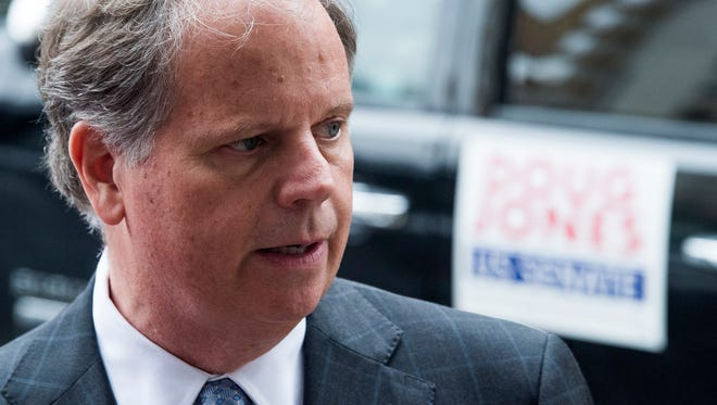 U.S. Senate candidate Doug Jones talks with the media after meeting with Alabama State University students at Touch of Soul Cafe in Montgomery, Ala. on Wednesday November 8, 2017.