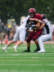 Roosevelt wide receiver Seth Baloun (4) is tackled