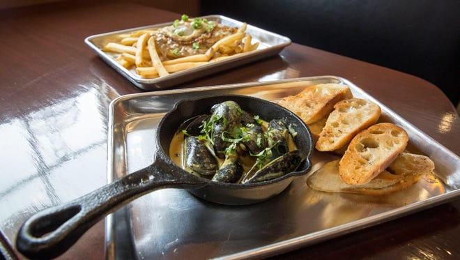 A serving of the curried bistro mussels and breakfast poutine that are two of the options on the restaurants menu.