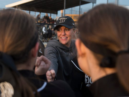 Boonville coach Alex Baumgart chats with her team after the Pioneers defeated Tell City 8-7 in their season opener.