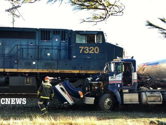 Road reopened after train vs  tanker truck accident