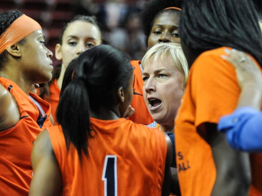 UTEP head women's basketball coach Keitha Adams talks with her team during a timeout during a recent game.