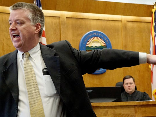Assistant prosecutor for Richland County, Cliff Murphy, points to defendant Mike Garn on Monday afternoon during opening statements in front of Judge Brent Robinson.