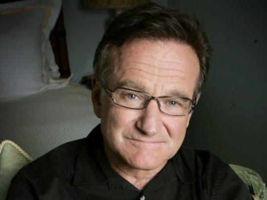 "This June 15, 2007, file photo shows actor and comedian Robin Williams posing to promote his film, ""License To Wed."""