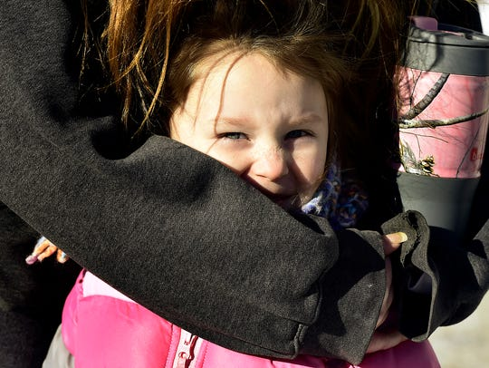 August Freet, 4, is protected from the chilly air by
