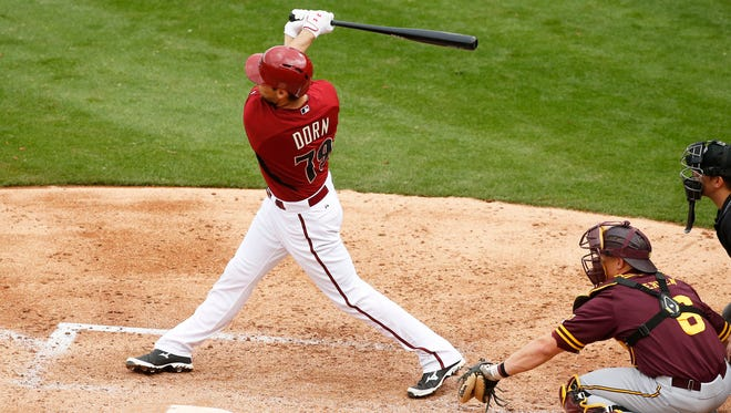 Arizona Diamondbacks Danny Dorn hits a 2-RBI double against Arizona State in the 5th inning during a spring training exhibition game on March 3, 2015 at Salt River Fields at Talking Stick