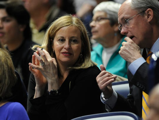 Nashville Mayor Megan Barry talks to Robert Forrest, a member of her security staff, at Bridgestone Arena on March 9, 2017. Barry has admitted to having an affair with Forrest.