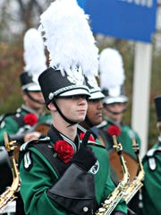 West Deptford High School Eagle Marching Band saxophone player Eric Mizner Jr. holds up q finger for no.1. The band won its 8th championship Nov. 5, 2017 in the Atlantic Coast Championships at Hersheypark Stadium in Pennsylvania.
