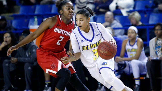 Delaware's Erika Brown (right) tries to get past Hartford's Sierra DaCosta in the second half of Delaware's 67-66 loss at the Bob Carpenter Center Wednesday.