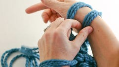 Arm knitting is done by looping yarn around your arms