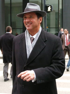 In this file photo, infomercial pitchman Kevin Trudeau leaves federal court in Chicago. Trudeau was ordered jailed Tuesday for failing to pay a $37 million judgement.