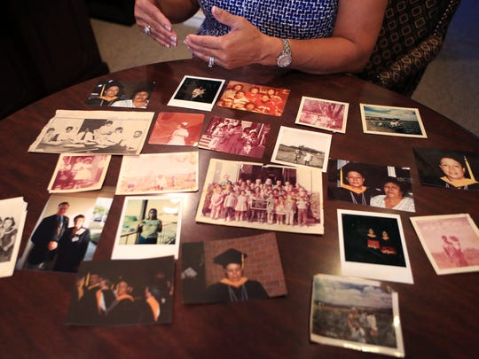 Estela Chapa is the chief clinical transformation officer at Christus Spohn Health System. Here she displays pictures of her family working as migrant farmworkers and snapshots from milestones in her life, such as her college graduation.