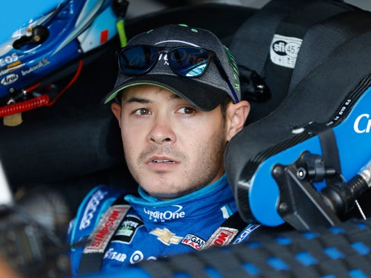 FILE - In this Friday, Oct 20, 2017 file photo, Kyle Larson sits in his car before practice for the NASCAR Monster Cup auto race at Kansas Speedway in Kansas City, Kan.  NASCAR's offseason is short, and Kyle Larson made sure to take advantage of every day of his break. He focused on racing. (AP Photo/Colin E. Braley, File)