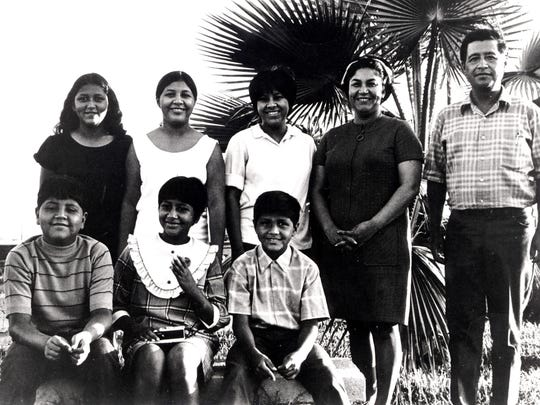 "Helen and Cesar Chavez with six of their eight children in 1969 at the United Farm Workers' ""Forty Acres"" property outside Delano. Standing from left are Anna, Eloise and Sylvia. Seated from left are Paul, Elizabeth and Anthony."