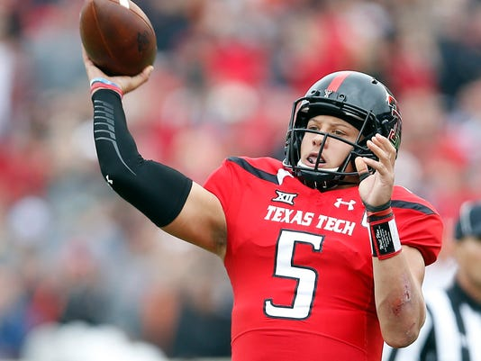 FILE - In this Nov. 5, 2016, file photo, Texas Tech's Patrick Mahomes (5) passes the ball during an NCAA college football game against Texas, in Lubbock, Texas. The closest Texas Tech and junior quarterback Patrick Mahomes will get to a bowl game this season is playing rival Baylor in an NFL stadium on the day after Thanksgiving. What's still unclear is if that will be the national passing leader's last game with the Red Raiders (4-7, 2-6 Big 12). (Brad Tollefson/Lubbock Avalanche-Journal via AP, File)