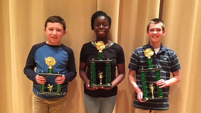 Winners of the 2018 Sioux Falls Regional Spelling Bee are seventh-graders (from left): Carson Weiner, Sioux Falls Christian School, third; Christine Awo Addo, Dakota Valley Middle School, second; and Ryan Presler, Brandon Valley Middle School, first.