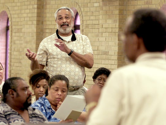Former Lafayette School Board member Dr. Raphael Baranco, center, makes a statement Tuesday April 23, 2002 during a public hearing called by the local NAACP on the desegregation plan. Photo by Brad Kemp