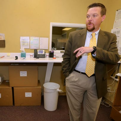 Trey King, director of Recovery Court, shows off the drug test room at the county's new probation department, on Wednesday, May 18, 2016.