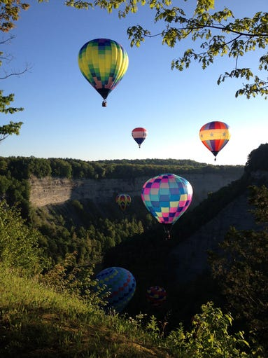 Hot air balloons rise above Letchworth State Park in