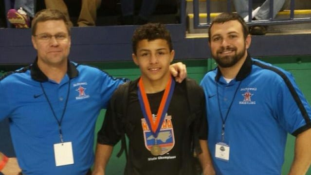 McDowell sophomore Toney McGee and the Titans wrestling coaches.