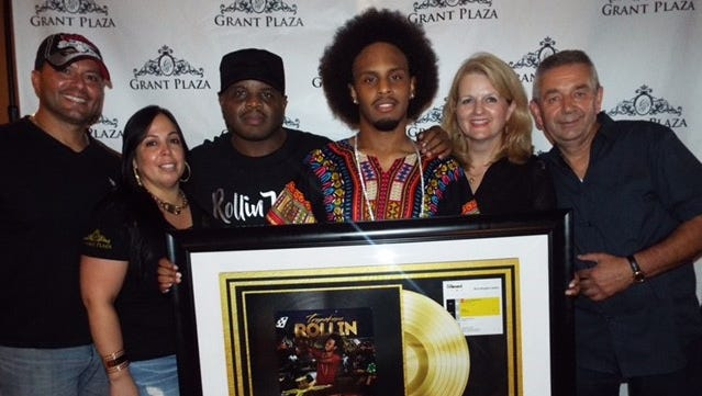 "Tropakana (fourth from left), also known as Jaquan Cooper, recently celebrated the release of ""Rollin'"" and the song's rise to No. 1 on the Billboard ""Hot Singles Sales"" chart."