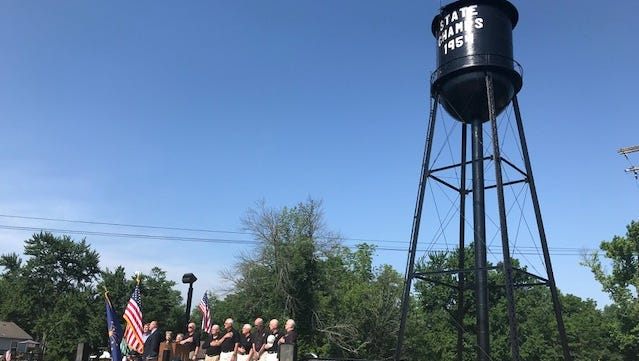 Members of Milan's 1954 state title team were honored with a rededication of the town's water tower.
