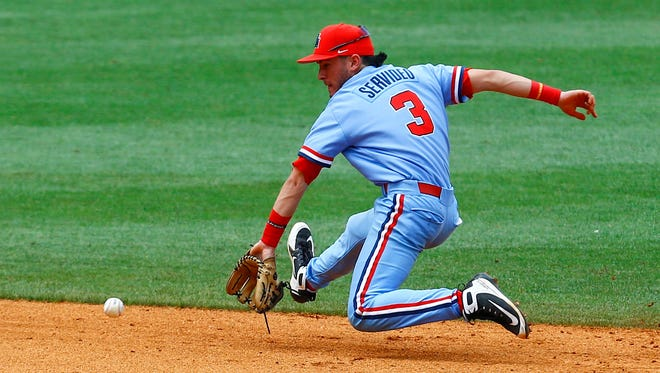 Mississippi shortstop Anthony Servideo (3) fields a ground ball before throwing to first for the out on LSU's Austin Bain during the third inning of the Southeastern Conference tournament NCAA college baseball championship game, Sunday, May 27, 2018, in Hoover, Ala. (AP Photo/Butch Dill)