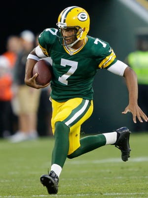 Green Bay Packers quarterback Brett Hundley runs for a first down against the New Orleans Saints during a preseason game at Lambeau Field on Sept. 3, 2015. Hundley will be Monday's guest on Clubhouse Live with co-host David Bakhtiari.