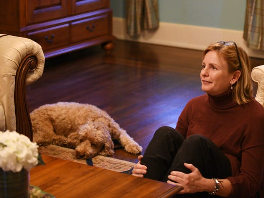 Corey Cohen uses relaxation, massage and meditation to train dogs. Mary Ellen Saar and her dog Finn have a session at their Midland Park home on Friday December 01, 2017.