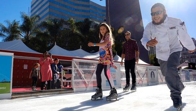 Visitors enjoy the warm weather as they ice skate in downtown Los Angeles on Nov. 22, 2017. Many locations in the Southwest are seeing their warmest November on record.