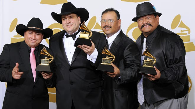 Los Texmaniacs leader Max Baca, second from left, has been hospitalized with COVID-19.