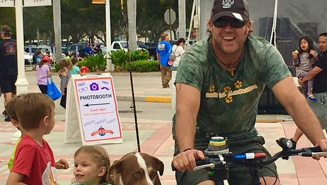 Jay Hamm and his canine companions have been biking across Florida in segments to bring awareness to pet therapy in the western community in memory of his sister.