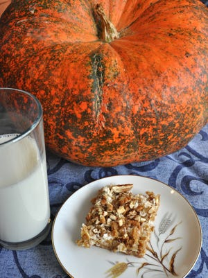 Pumpkin Hello Dolly Bars feature pumpkin puree instead of chocolate chips.
