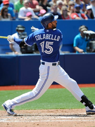 Blue Jays first baseman Chris Colabello hits a two-run