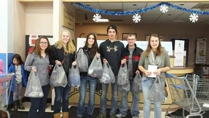 FFA officers shopping for families in need over the holidays were, from left, Gianna Fisher, Emily Baumgartner, Claire Hrubecky, Kyle Junk, Reggie Stinson and Amanda Langley.