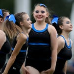 11-year-old Emily Kruger wouldn't let a near coma stop her from cheering