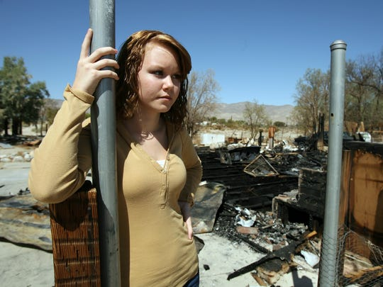 Jaylynn Keith, pictured here at the scene of a house fire in 2007, was found dead in a Palm Springs apartment in March 2017. Her boyfriend, James Beushauser, has been convicted in her death and on Monday was sentenced to 50 years in prison.