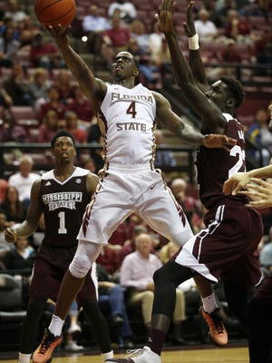 FSU's Dwayne Bacon lays the ball up past Mississippi State's Fallou Ndoye during their game at the Civic Center on Wednesday.