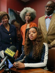 NAACP New York State Conference president Hazel Dukes, far left, stands near her god-daughter civil rights activist Tamika Mallory, seated, as she speaks during a press conference at the office of her attorney Royce Russell, far right, Tuesday Oct. 17, 2017, in New York.