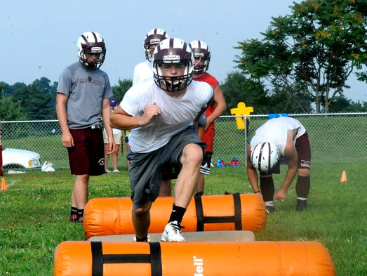 John Mark-Burnett runs over bags on Wednesday during technique drills at Stuarts Draft. The Cougars were practicing for the first time this season under first year head coach Nathan Floyd.
