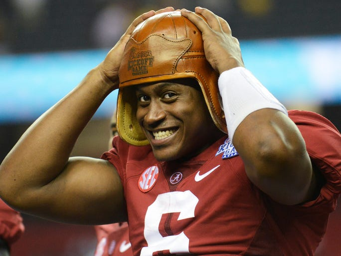 Alabama quarterback Blake Sims (6) puts on the Old Leather Helmet after the Chick-fil-A Kickoff Game at the Georgia Dome in Atlanta, Ga. on Saturday August 30, 2014.