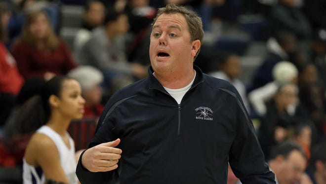 A state auditor found that Chris Cundiff deposited more than $19,000 from donations, fundraising proceeds and player contributions into a bank account he controlled while coaching the Roosevelt girls' basketball team.